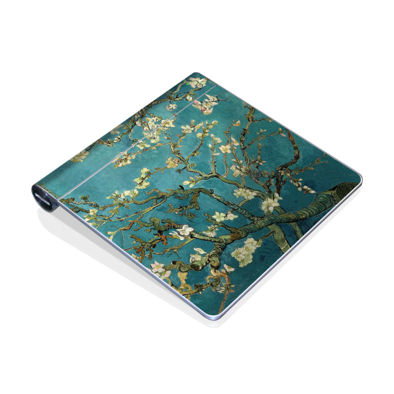 Apple Magic Trackpad Skin design of Tree, Branch, Plant, Flower, Blossom, Spring, Woody plant, Perennial plant with blue, black, gray, green colors