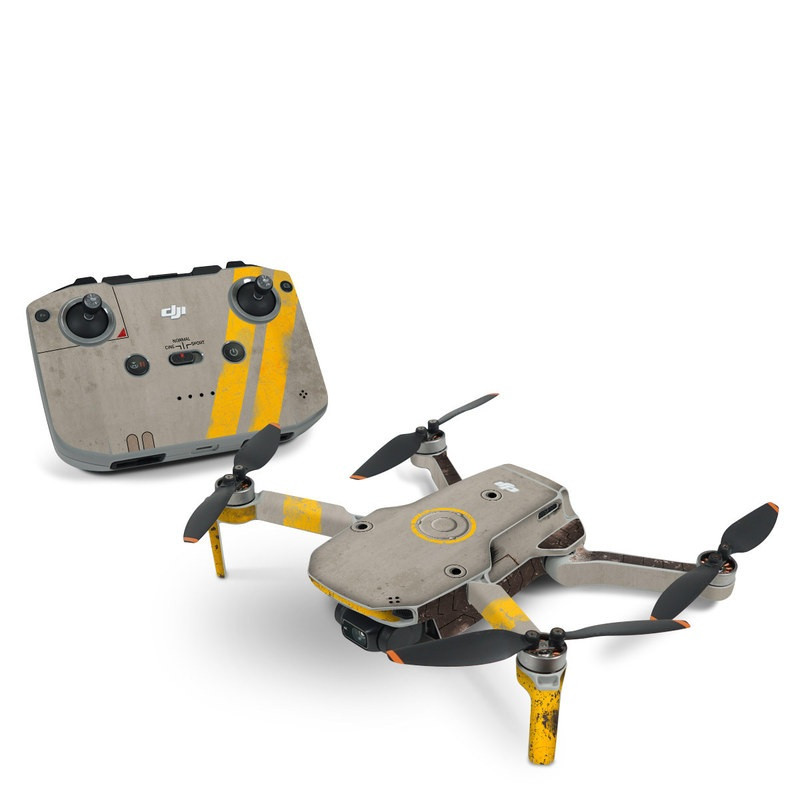 DJI Mini 2 Skin design of Yellow, Wall, Line, Orange, Design, Concrete, Font, Architecture, Parallel, Wood with gray, yellow, red, black colors