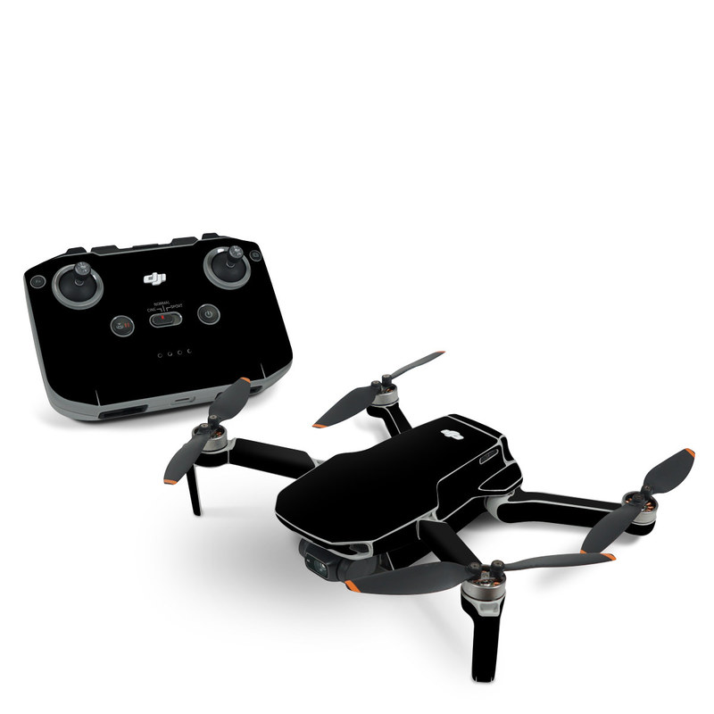 DJI Mini 2 Skin design of Black, Darkness, White, Sky, Light, Red, Text, Brown, Font, Atmosphere with black colors