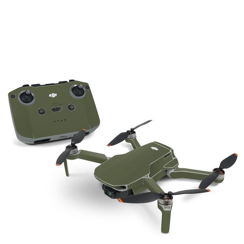 DJI Mavic Mini 2 Skin design of Green, Brown, Text, Yellow, Grass, Font, Pattern, Beige with green colors