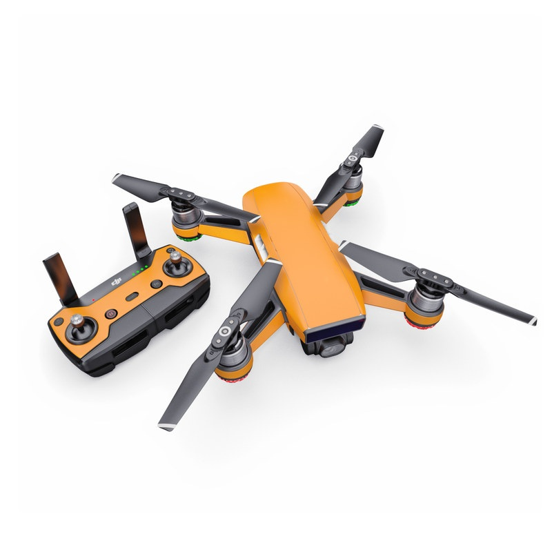 DJI Spark Skin design of Orange, Yellow, Brown, Text, Amber, Font, Peach with orange colors